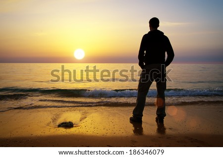 Man on the shore. Relax composition. - stock photo