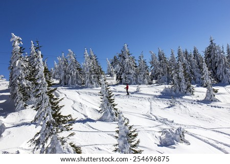 Man on the ski lift - stock photo