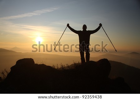 Man on the top of mountain - stock photo