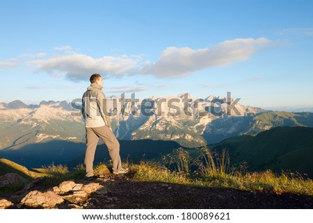 Man on the top of the mountains. Dolomites, Italy - stock photo