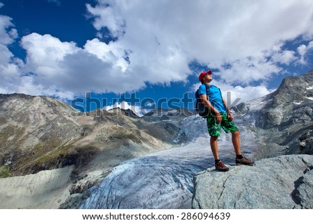 man on the track in the high mountains