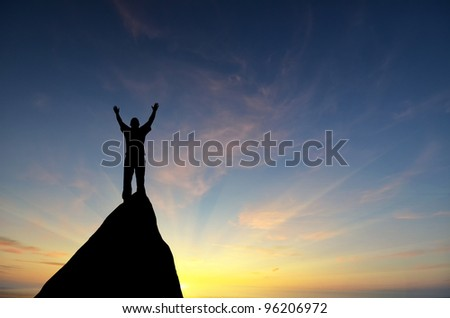 man on top of a mountain in the sky with bright lightning