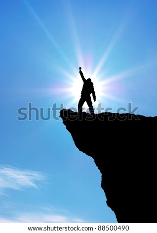 Man on top of mountain. Conceptual design. - stock photo