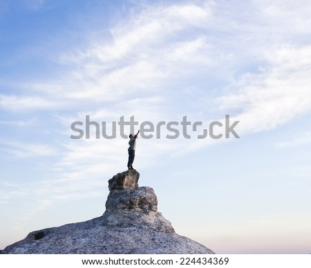 Man on top of mountain. Conceptual scene. - stock photo