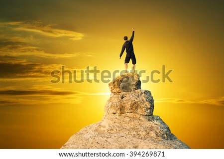 Man on top of mountain. Conceptual scene. - stock photo