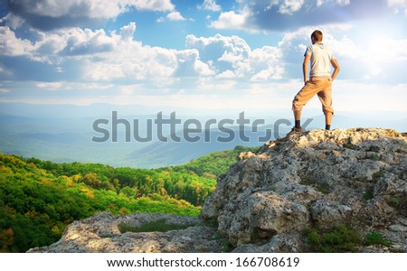 Man on top of mountain. Element of design. - stock photo