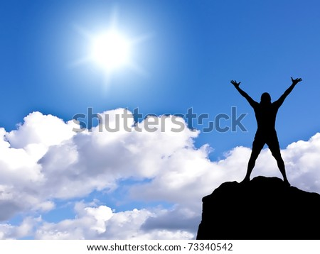 man on top of the mountain against the backdrop of sunny sky - stock photo