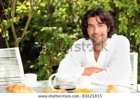 man on vacation having his breakfast - stock photo