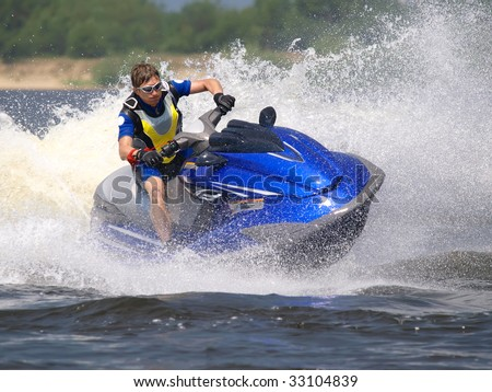 Man on Wave Runner turns fast  on the water