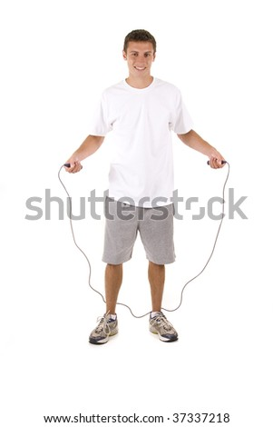 Man on white holding a jump rope. - stock photo