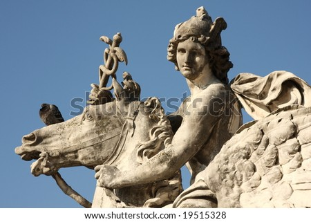 Man on winged horse in paris - stock photo