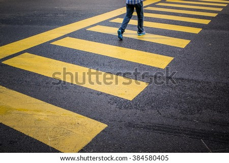 Man on zebra crossing. - stock photo
