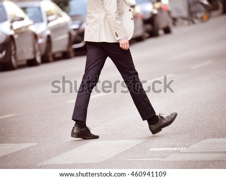 Man on zebra crossing, leaving, exiting