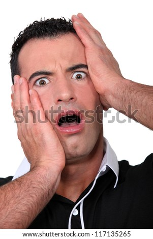 Man open mouthed in horror - stock photo