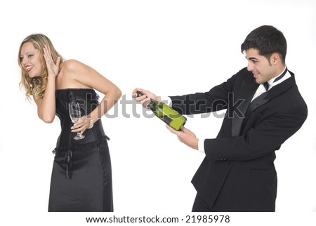 man opening a champagne bottle at a party with her girlfriend - stock photo