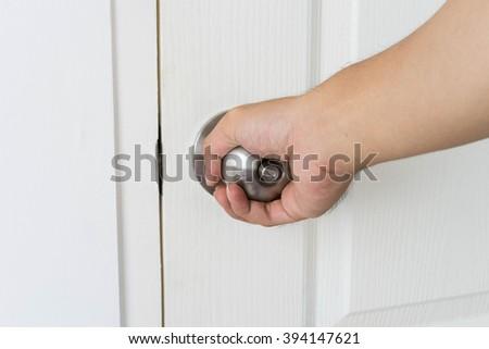 Man opening  door knob - stock photo