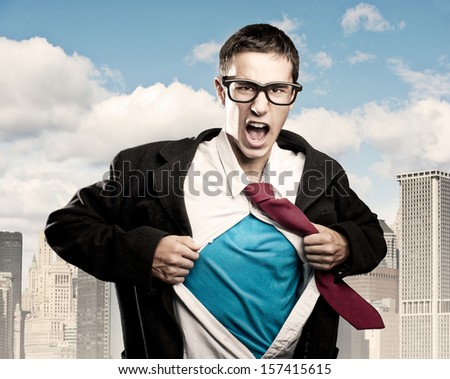 man opening her shirt like a superhero - stock photo