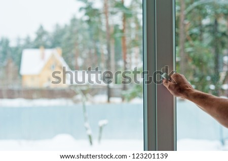 man opens the window - stock photo