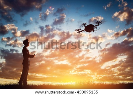Man operating a drone at sunset using a controller. 3D rendering