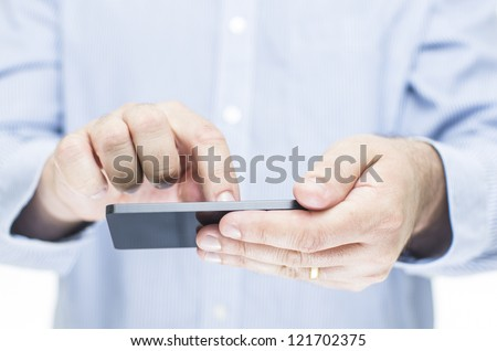 Man operating a touchscreen mobile phone - stock photo