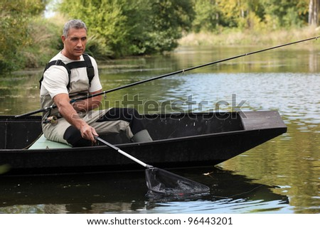 Man out fishing - stock photo