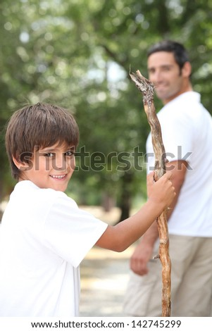 Man out for a walk with his young son - stock photo