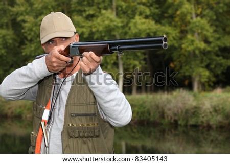 Man out hunting - stock photo