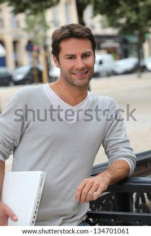 Man outside with laptop