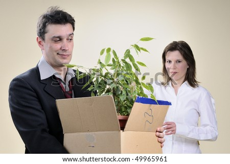 man packing his stuff and upset colleague - stock photo