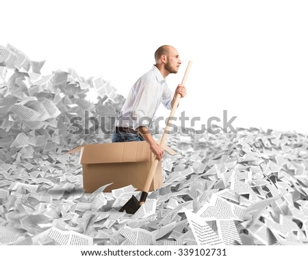 Man paddling in a sea of sheets - stock photo