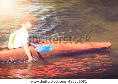 man paddling in kayak is on a river, kayaking