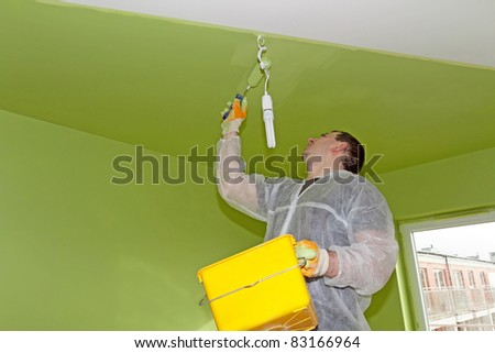 Man painting a ceiling - stock photo