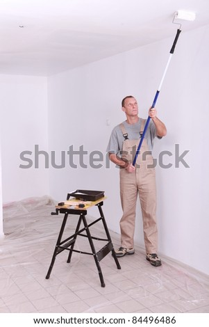 Man painting a room white - stock photo