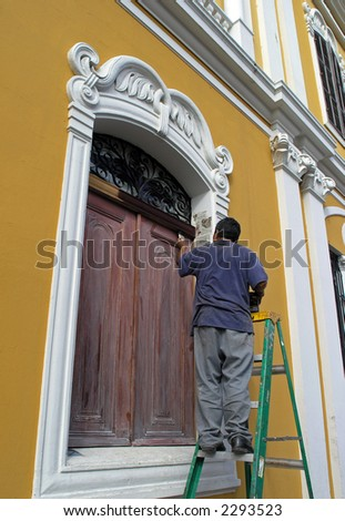 man painting old house - stock photo