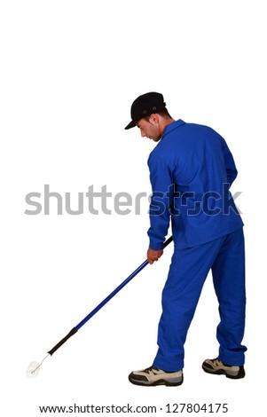 Man painting the floor - stock photo
