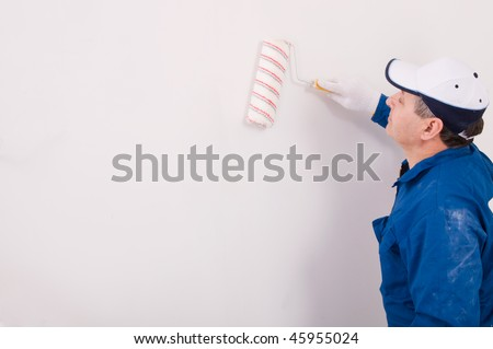 Man painting the wall - stock photo