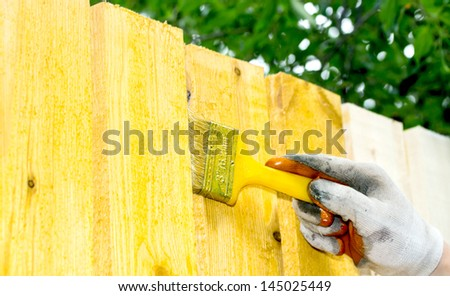 Man painting wooden furniture piece - stock photo