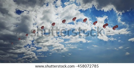 Man parasailing in the sky captured in different phases. Extreme sport. - stock photo