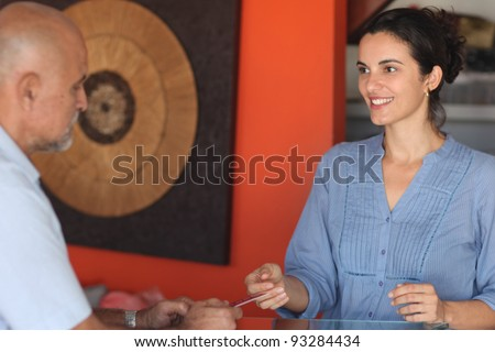 Man paying with credit card - stock photo