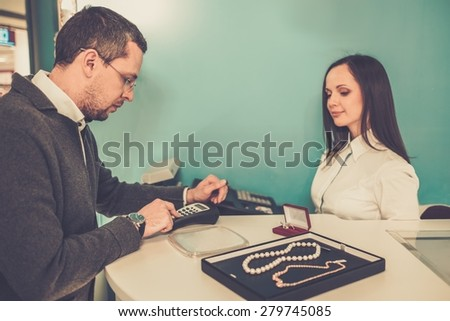 Man paying with credit card in  jewellery shop  - stock photo