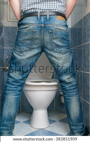 a man peeing in toilet
