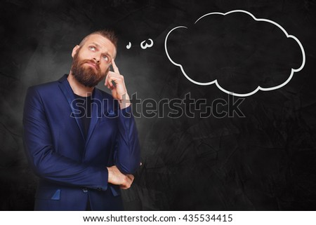 Man pensive with thinking cloud. Young man thoughtful. Caucasian man thinking at black gradient background. Serious stylish guy with beard consider some idea. - stock photo