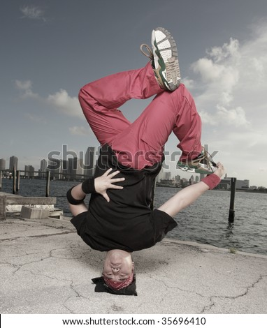 Man performing a breakdancing headstand