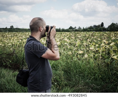 Man photographing a field