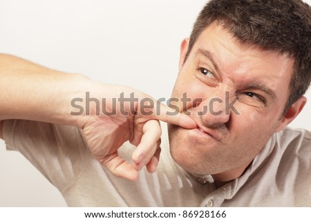 Man picking food from his teeth