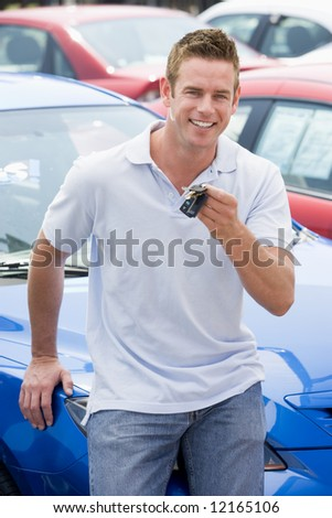 Man picking up new car from lot