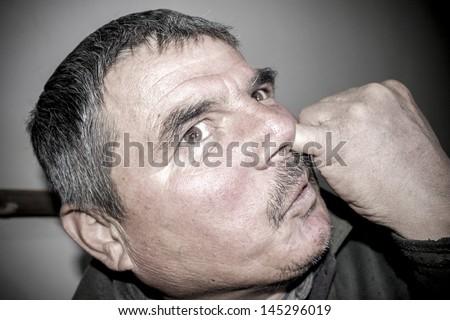 man picks his nose - stock photo