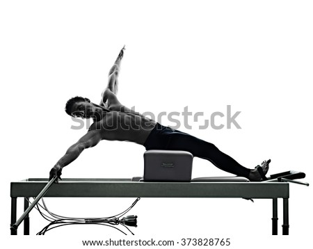 man pilates reformer exercises fitness isolated - stock photo