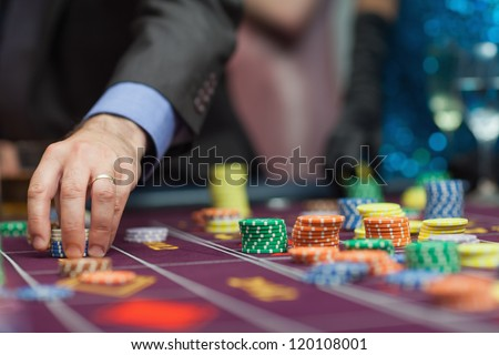 Man placing a bet at the casino - stock photo