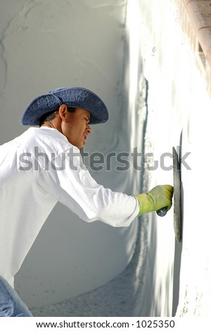 Man Plastering Swimming Pool - stock photo